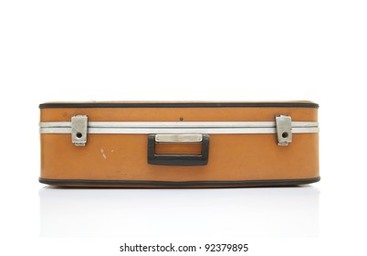Old fashioned suitcase on isolated white background with reflection