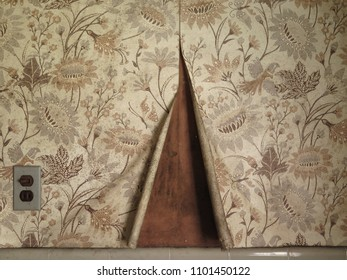 Old fashioned wallpaper in an abandoned home. Vintage.