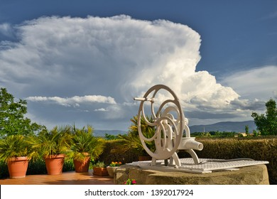 Old fashioned well pump in front of a dramatic cloud formation
