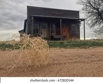 Old fashioned western wooden store building abandoned and deteriorating