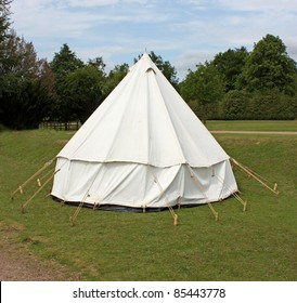 An Old Fashioned White Canvas Bell Camping Tent.