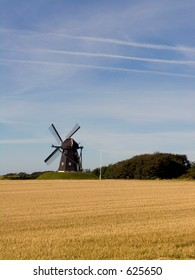 Old fashioned windmill in landscape