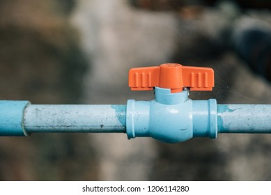 Old faucet rusty with a water leak, Water leak from water tap. Blue plastic water pipe.