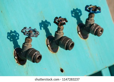 Old Faucets Spigots In Blue Turquoise Painted Plywood No Hose No Water Selective Focus