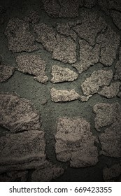Old felt roofing tar fragment as an abstract background