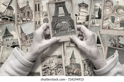Old female hands hold vintage landmarks travel photos. Belgium, France, the Netherlands, Germany, Israel, Russia. World travel memory. International tourism. Vacation and travel