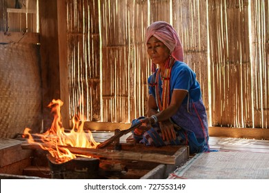 Old female karen hill tribe is cooking traditional in the cottage of northern Thailand at Mae Klang Luang, Mae Chaem, Chiang Mai Province