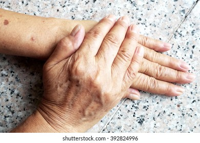 Old female/woman hands on marble background.