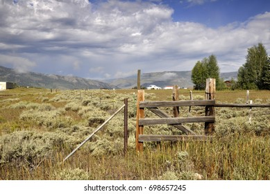 old fence gate by a prairie in Colorado