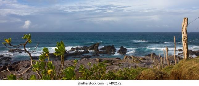 An old fence on a rocky seashore at famous Hookipa surf spot, Maui, Hawaii.