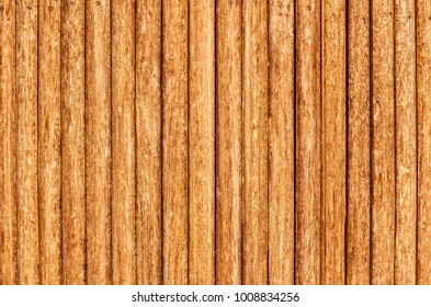 Old fence of wooden stakes (wooden background)