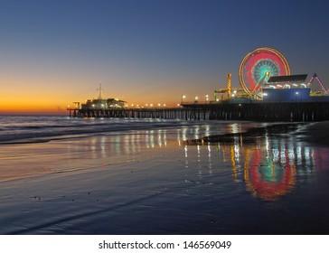 Old Ferris Wheel and Santa Monica Pier at Twilight. Santa Monica, California, USA.