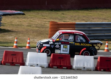 An old Fiat 500 Abarth racing car speeding on Tazio Nuvolari circuit during a competition. Italy-Cervesina 07 October 2018