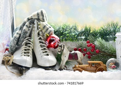 old figure skates,woolen socks and vintage style toys as Christmas decoration on window sill