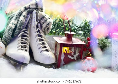 old figure skates,woolen socks and vintage style lanterns as Christmas decoration on window sill
