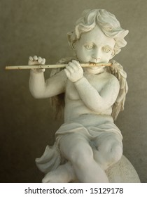 Old Figurine - Flute Playing Angel