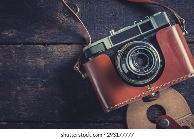 Old film camera on wooden background