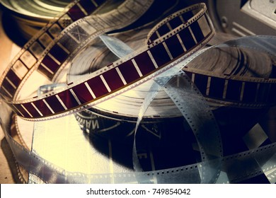An old film with a movie on the roll. Background for advertising old cinema