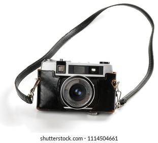 Old film photo-camera isolated on white background.