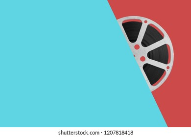 old film reel on colour background