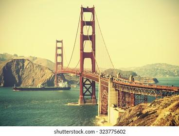 Old film retro style Golden Gate Bridge in San Francisco, USA.