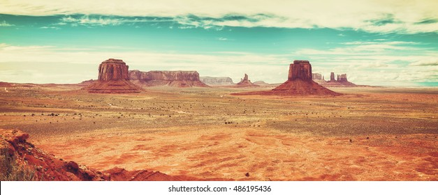 Old film retro stylized panoramic picture of Monument Valley, USA.