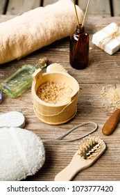 Old Finnish Sauna SPA Concept, handmade soap, Bottle with scented sticks, salt for foot bath,shampoo,sponge and others body care accessories on old wooden rustic sauna boards,