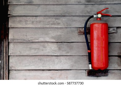 Old Fire extinguisher on wooden wall