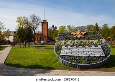 Old fire station and park with flower composition. Daugavpils, Latvia.