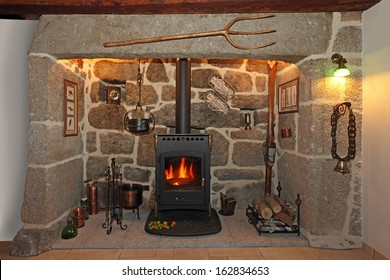 old fireplace made of stone and iron stove
