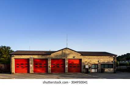 Old firestation near Hudderfield in Yorkshire England. Red doors and blue sky show a good contrast between colors.