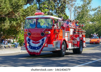 Old Firetruck and people at the July 4th Independence Day Parade in Rancho Bernardo, San Diego, California, USA. 07/04/2019