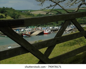 The old fish quay at Salcombe seen through a gate from Snapes point