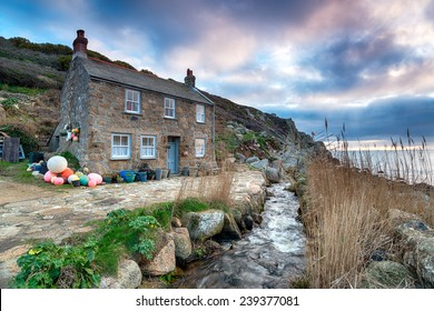 Old fisherman's cottage on the South West Coast Path at Penberth Cove, a small fishing village near Penzance in Cornwall