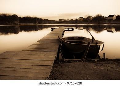 Old fishing boat ashore lake