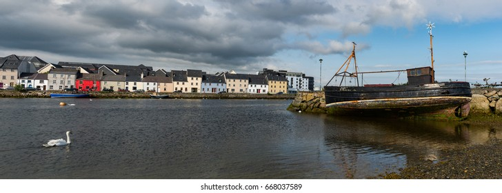 Old fishing boat and houses in the distance of the Claddagh area of Galway city.Ireland