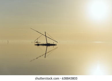 old fishing boat in a lake