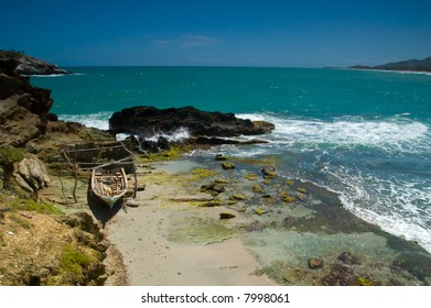 Old fishing boat left to the shore of Caribbean sea