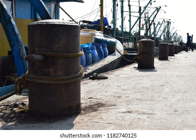 Old Fishing Boat on the Harbor and fishing net and Anchor and rope