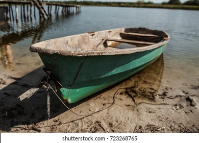 old fishing boat on the river or lake bank