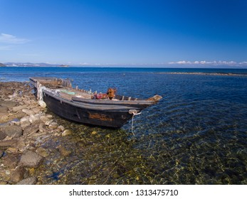 Old fishing boat on the shore of East Sea