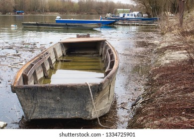 Old fishing boat on the tranquil surface of Danube river in Vukovar, Croatia