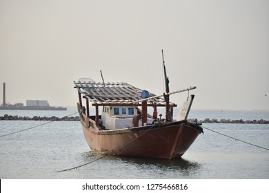 Old fishing boats in the cost of Dammam city beach