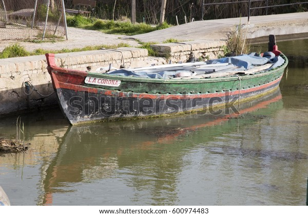 Old fishing boats in La Albufera lake nature reserve, El Palmar, Valencia, Comunidad Valencia on March 8, 2017