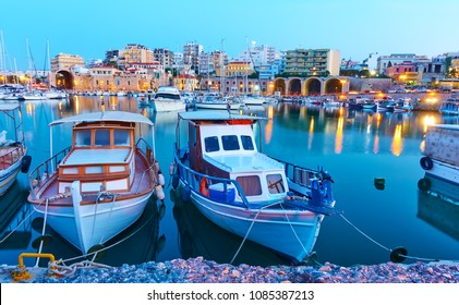 Old fishing boats in port of Heraklion in the evening,  Crete, Greece