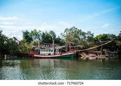 Old fishing boats in river, Thailand