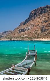 Old fishing bridge in turquoise lagoon. Balos bay, Crete, Greece.