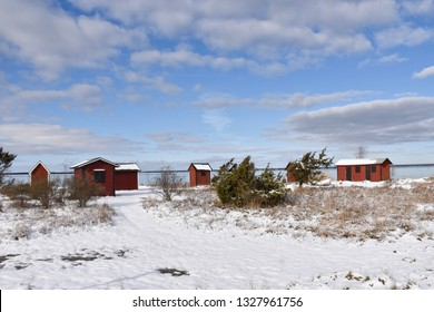 Old fishing cabins in winter season by Farjestaden at the swedish island Oland