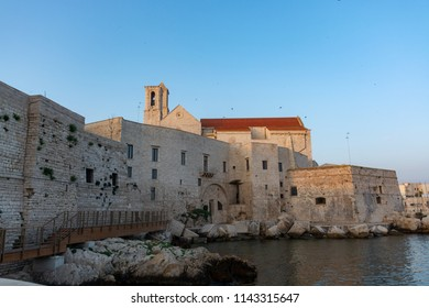 Old fishing harbor with colorful wooden boats in old small city Giovinazzo near Bari, Apulia, Italy in early morning