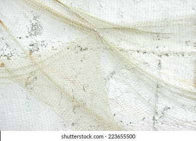 Old Fishing Net on White Wall. Background and Texture for text or image